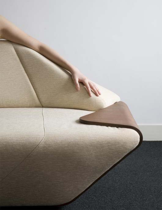 Hex Sofa by Nosigner 3 Hex Sofa with side table on the edge by Nosigner