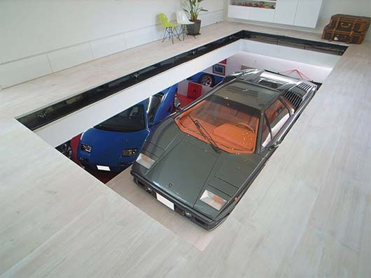 KRE House by Takuya Tsuchida 1 House with garage   see the car in the living room